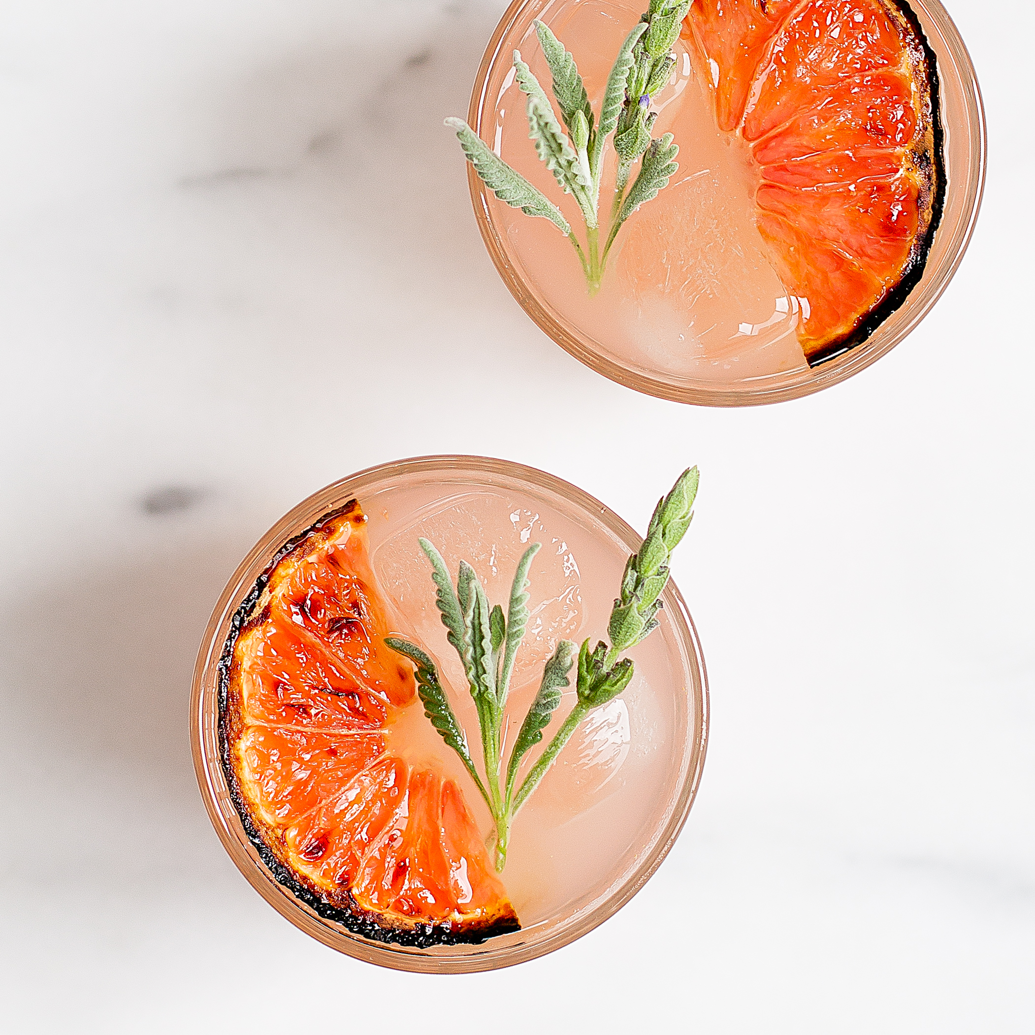 A two ingredient recipe for the prettiest, easiest spring cocktail ever. Lavender infused vodka and brûléed grapefruit come together in a drink that guests won't forget.